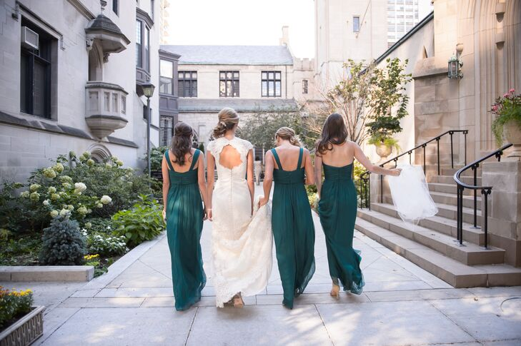 Each of Christina's bridesmaids wore emerald green floor-length Amsale gowns in various styles. To complement the bride's pearl-and-emerald earrings (that belong to her mom), each bridesmaid wore vintage costume jewelry.