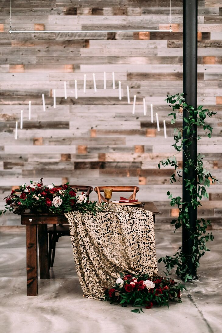 Wood Sweetheart Table with Burgundy Flowers, Printed Fabric and Floating Candles