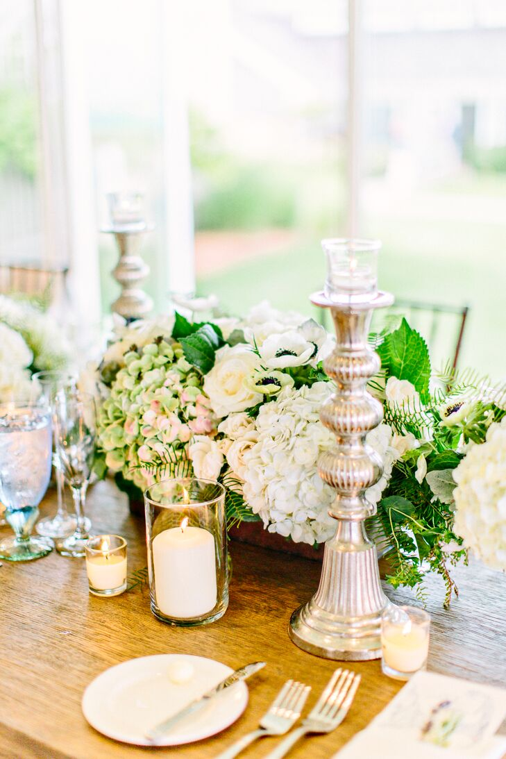 While the florals certainly set a chic, romantic tone for the decor, it was the more subtle details that truly pulled the couple's vision together. Silver candlesticks, warm candlelight and vintage-inspired mint glasses introduced undeniable ambiance to the elegant dining room at the Chatham Bar Inn's Beach House Grill.