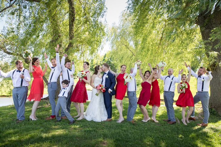 As a nod to Memorial Day weekend, when their wedding took place, Tara and Graeme chose a red, white and blue theme for their wedding party's attire. Tara had her bridesmaids choose their own dresses in any shade of red, giving them Kate Spade earrings to pair with them. The groomsmen wore classic white button-down shirts and gray-blue trousers from Banana Republic, which they paired with playful bow ties and suspenders.