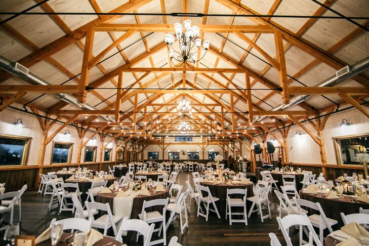 The reception was held in the barn at Rosebank Winery. The venue features cathedral ceilings, exposed wood beams and chandeliers.