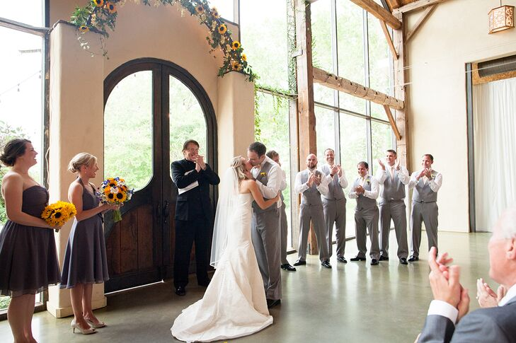 """Carly purchased her Coren Moore dress from a small boutique in Greenwich, Connecticut. """"The neatest part of the dress is that the designer sews in the 'something blue' to the inside of the gown—your initials and the wedding date,"""" says the bride."""