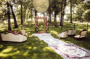 Backyard Ceremony with Rugs, Flower Arch and Vintage Lounge Furniture