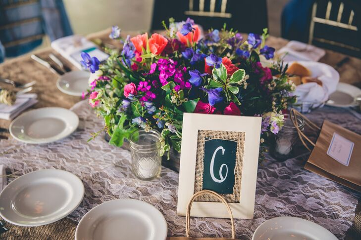 The reception tables were numbers with taupe framed chalkboard signs with a burlap inlay to match the reception's rustic shabby-chic look.