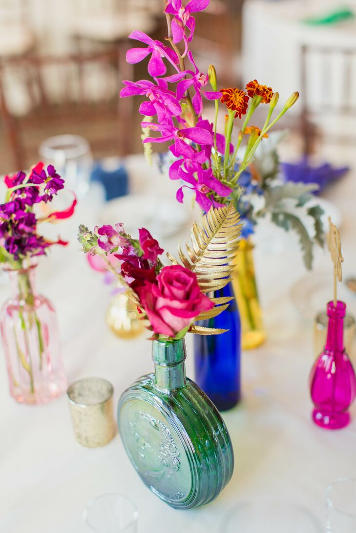 """""""Our awesome florist, Sarah Lambert from Soirees and Bouquets, scoured flea markets and antique stores for jewel-toned vintage vases for the centerpieces on the tables,"""" Chelsea says. """"She even hand-covered a bunch of the leaves and flowers in shiny gold. Absolutely perfect!"""""""