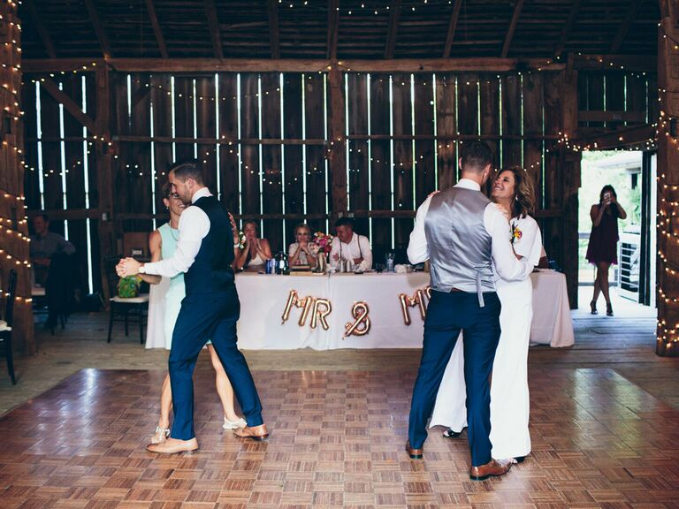 Grooms dancing with moms at wedding reception