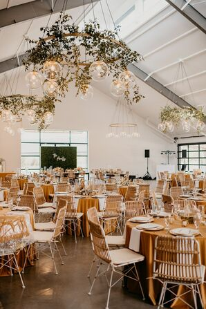 Modern Bohemian Reception with Neutral Colors and Round Chandeliers