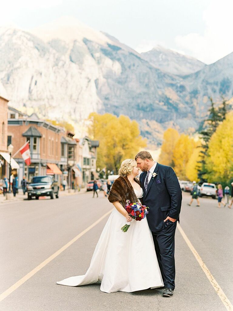 bride and groom outside in Telluride, CO