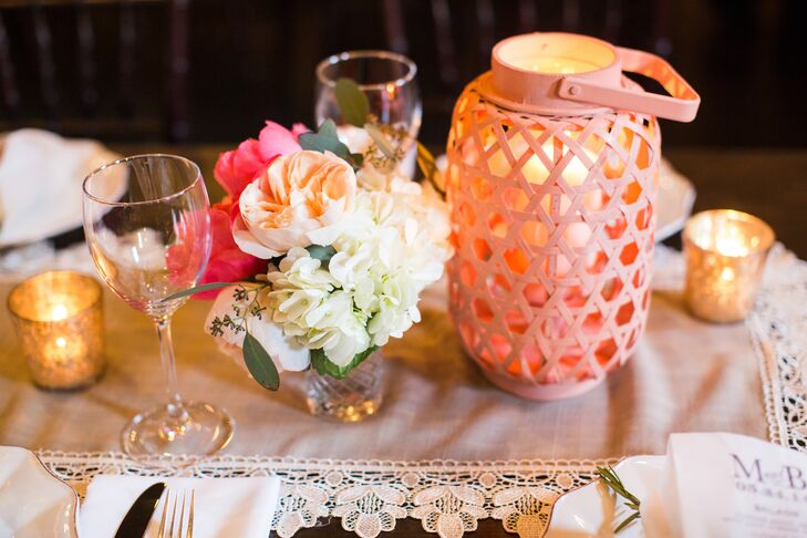 Garden roses, peonies and hydrangeas topped the wooden farm tables at the reception. They added a little softness to the geometric lanterns.
