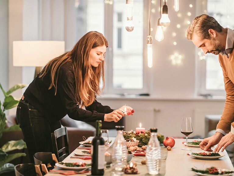 couple prepping dinner table