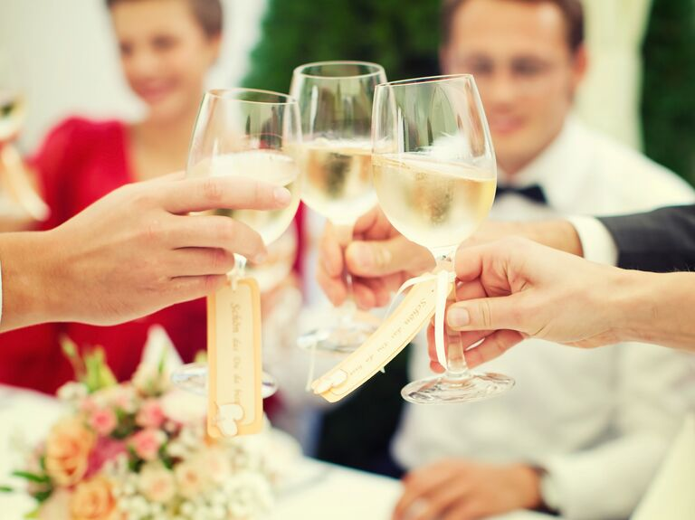 cae60179b67 Guests toast with wine at a wedding. Shutterstock Images. Oenophiles have  no problem selecting their favorite wines for dinner parties—but ...