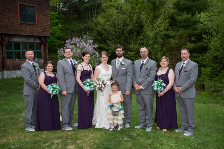 Rachel and Mark went classic went it came to their wedding party's attire to balance out the rustic feel of their venue. The groomsmen wore classic gray suits with purple ties and pocket squares and playful Sperry Topsider sneakers, while the bridesmaids wore long plum chiffon gowns with straps and sweetheart necklines.