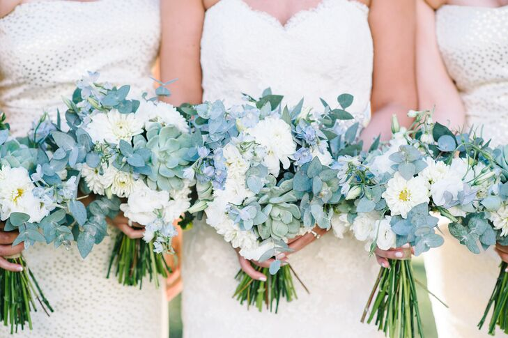 The bridesmaids' bouquets played off of Jaci's own and were filled with a mix of eucalyptus, succulents, blue delphiniums and white dahlias, lisianthuses and mums. The colors tied in seamlessly with the soft hue of their dresses, as well as the Legare Waring House's natural setting.