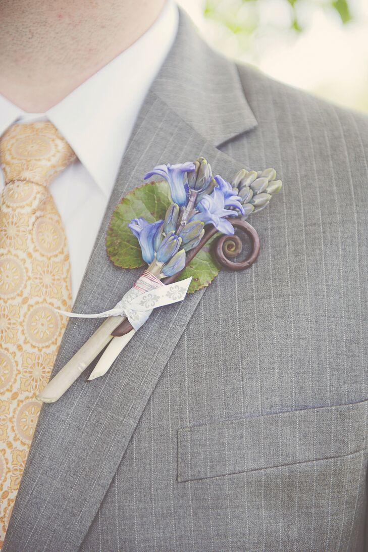 The groom's boutonniere featured grape hyacinths and fiddleheads. The couple went with a loose color scheme of gray and yellow, with complements of purple.
