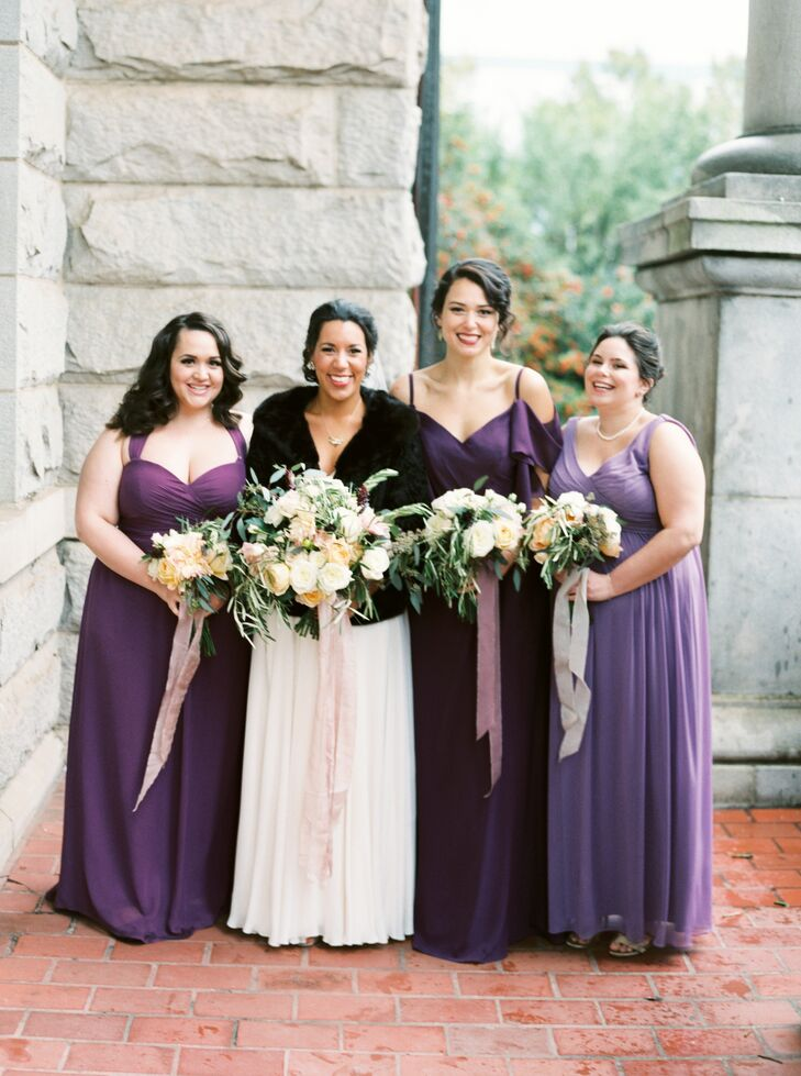 """""""I had three bridesmaids and one male attendant, and my younger brother was my man of honor,"""" Sydney says. """"Since my group was so diverse in look and height, I wanted to have them wearing complementary attire but nothing uniform."""" The ladies wore long gowns in shades of burgundy and purple, while men sported classic tuxedos with a burgundy pocket square."""