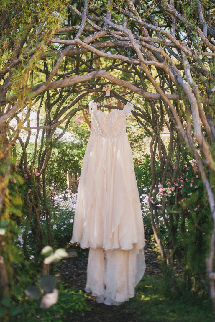 Kelley found her Modern Trousseau dress locally at Kelly's Closet and fell for its bohemian style with purposefully tattered sections of lace. She added sleeves to make it more her own.
