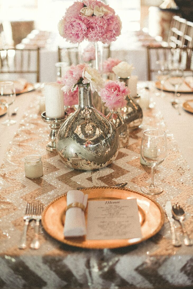 "The centerpieces consisted of pink peonies and white roses in mercury glass and small pillar candles. The reception tables were completed with sparkly gold chevron table runners. ""I needed everything to reflect the style I have acquired directing photo shoots and the beautiful flowers I've seen on my trips to Paris,"" Nikki says."