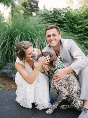 Couple with Dog during Their Outdoor Wedding