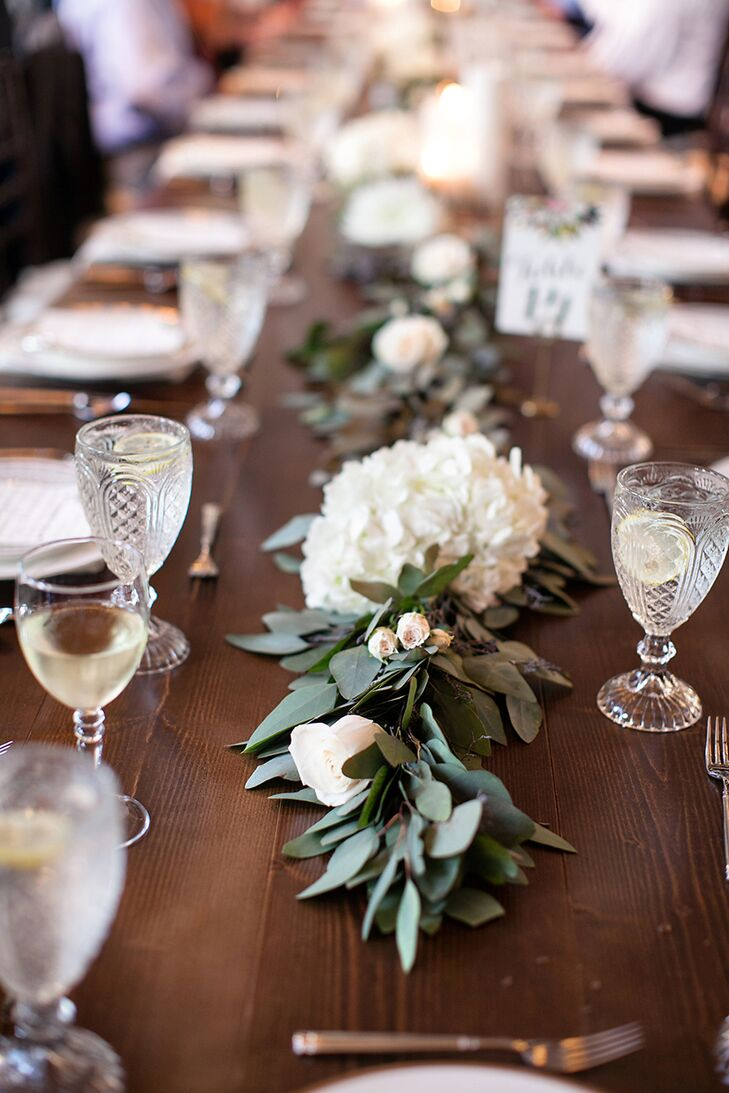 The beautiful bridesmaid bouquets were cleverly repurposed for the reception after the ceremony. Each bouquet was placed along the middle of the dining tables, and the abundance of peonies and roses created a lush feel while also keeping the floral budget in check.