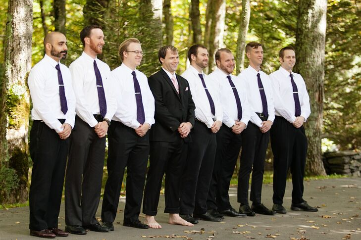 Groom in Black Suit Without Shoes