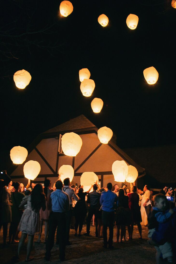 The guests released paper lanterns into the night at the end of the reception.