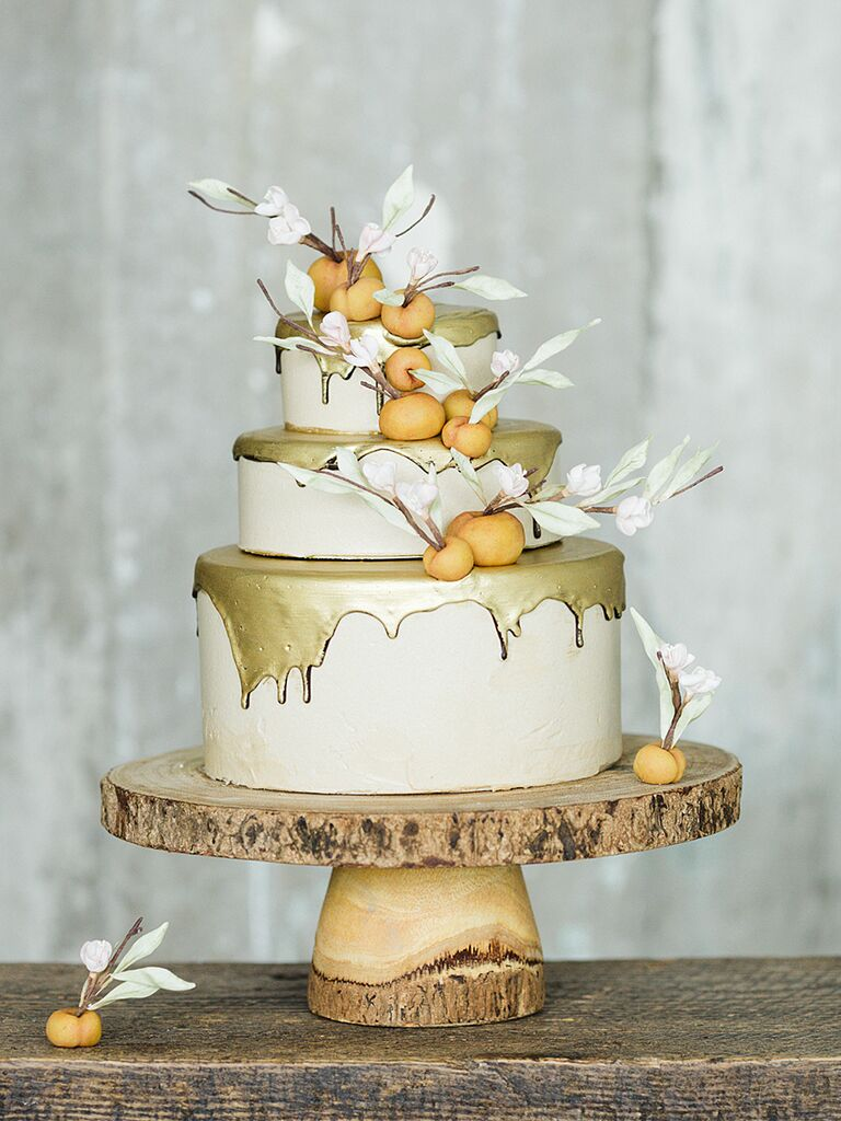 Metallic Gold Drip Wedding Cake With Fondant Peaches