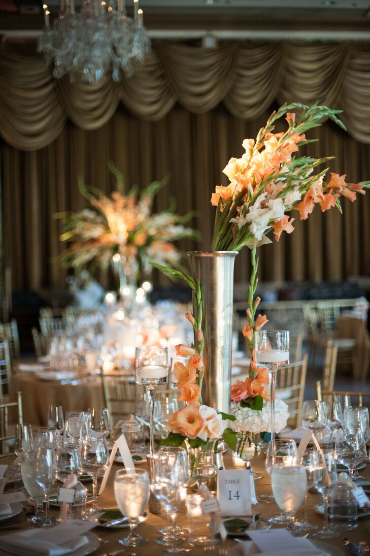 Different tall arrangements of peach and white gladiolus made up the floral centerpieces at the reception.