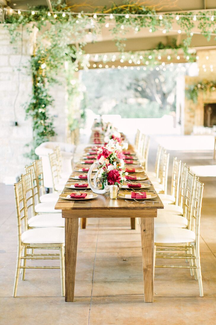 The three tablescapes on the handmade farm tables included overflowing blooms and greenery, floral arrangements, votives, antlers, moss and magnolia leaf garlands.