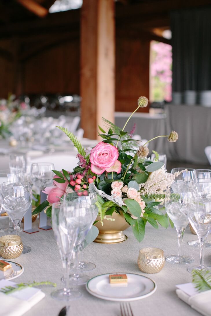 When it came to the reception, Viridescent Floral Design didn't disappoint. The florists put a contemporary twist on classic centerpieces by combining garden roses, ranunculus, astilbes, scabiosas, wildflowers and a variety of greenery into bold, dynamic arrangements that brought the decor to life.