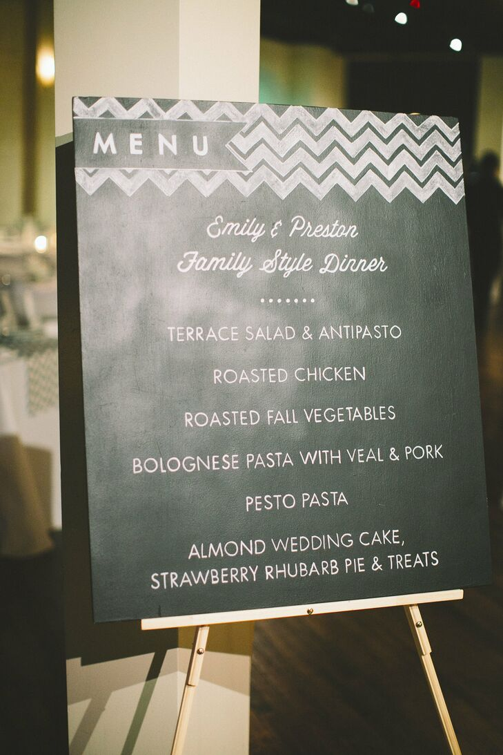 In lieu of menu cards, the couple chose to showcase their family-style dinner menu on a chalkboard.