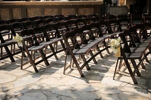 Brown Folding Chairs with Floral Aisle Decor