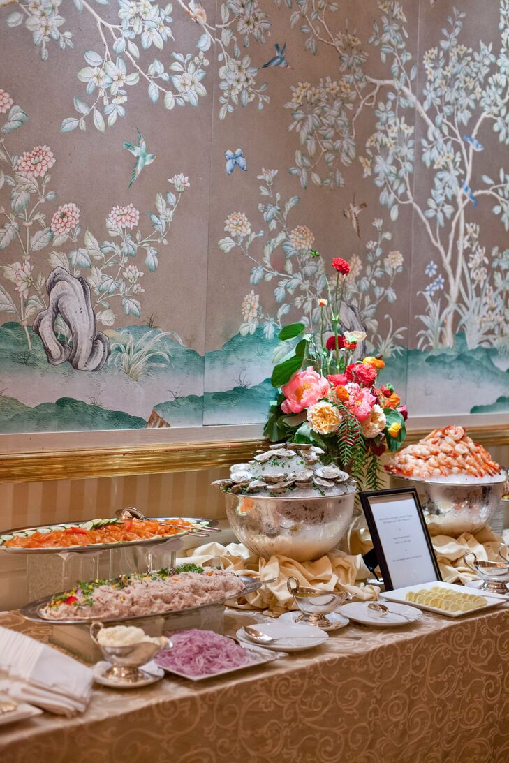 Oysters, shrimp and other raw items were displayed on ice in a raw bar during the reception.