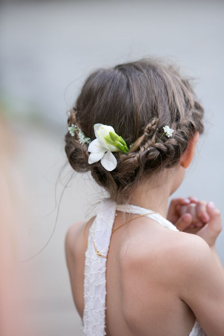 The flower girls wore their hair twisted back in braids and adorned with a tuberose and queen ann's lace.