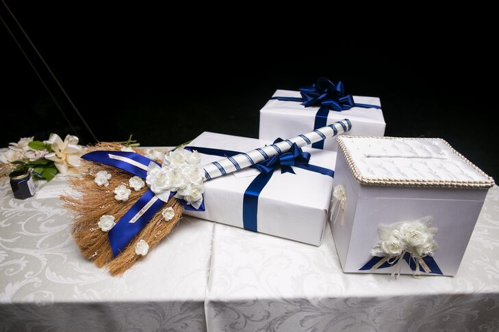 Dawnyelle and Barry wanted to take part in the tradition of jumping the broom. Barry's mother designed the broom, the handle was wrapped with ivory and blue ribbon and the bristles were decorated with flowers and navy blue ribbon.