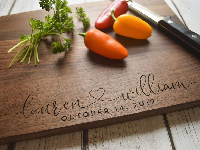 Personalized cutting board engraved with couple's names and wedding date