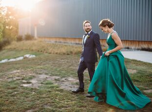 Kathleen Perniciaro (30 and a construction project manager) set her sights on a green gown while planning her modern gallery wedding to Will Duggins (
