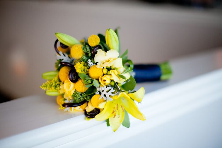 The bridesmaids bouquets were cheery bunches of craspedia, dusty miller, yellow lilies and fiddlehead fern.