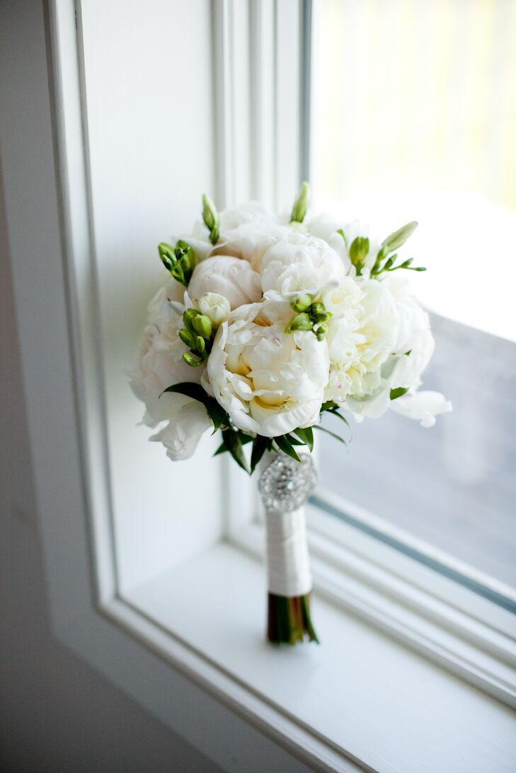 Jackie carried an organic bridal bouquet of fluffy white peonies. A broach belonging to her late aunt was pinned to the stems as her something old.
