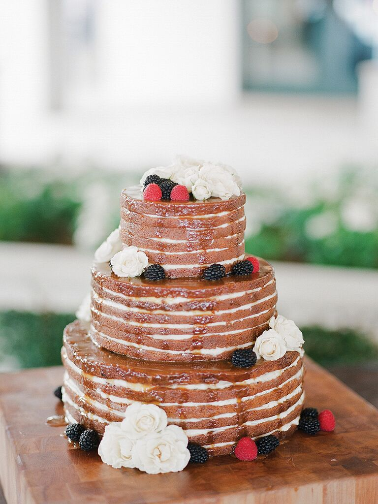 Naked carrot cake wedding cake drizzled with caramel sauce