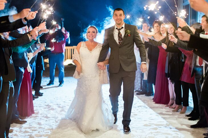 Couple Exiting with Sparklers at Stowe Mountain Lodge in Vermont