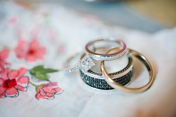 Adrienne wore a princess cut diamond wedding band by Jeff Cooper Designs while Cameron wore David Yurman's Streamline Collection band with black pave diamonds.