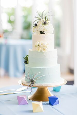 Tiered Buttercream Cake with White Cake Flowers on Gold Cake Stand