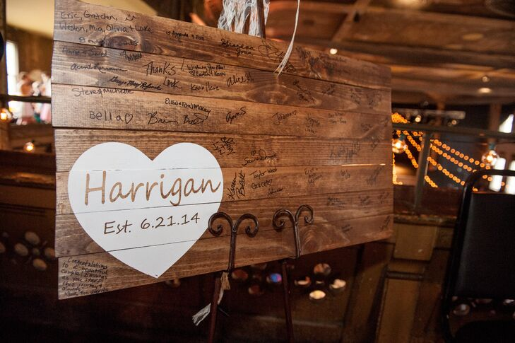 In keeping with the rustic elements of the decor, Amber and Andy's guest book was a wooden sign guests could write on.