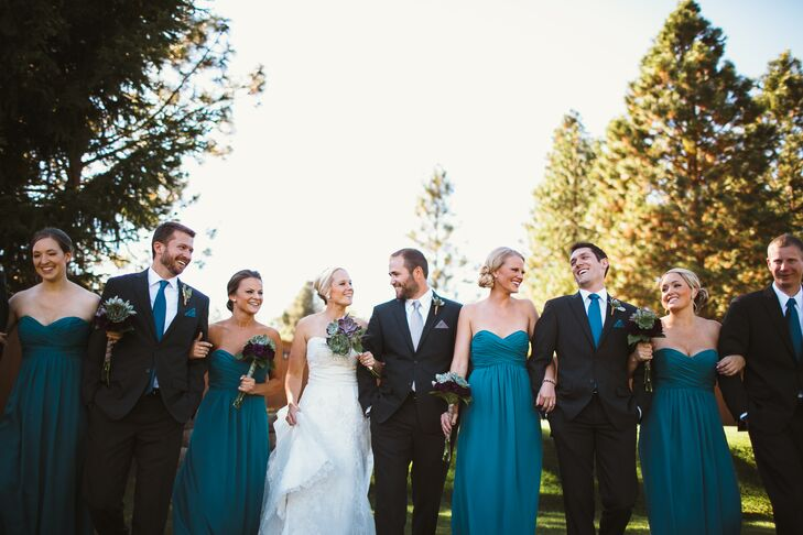 Bethany and Lucas walked with their wedding party dressed in teal accents. The bridesmaids wore strapless floor-length Alfred Angelo dresses in a teal color, which the groomsmen matched with their teal ties.