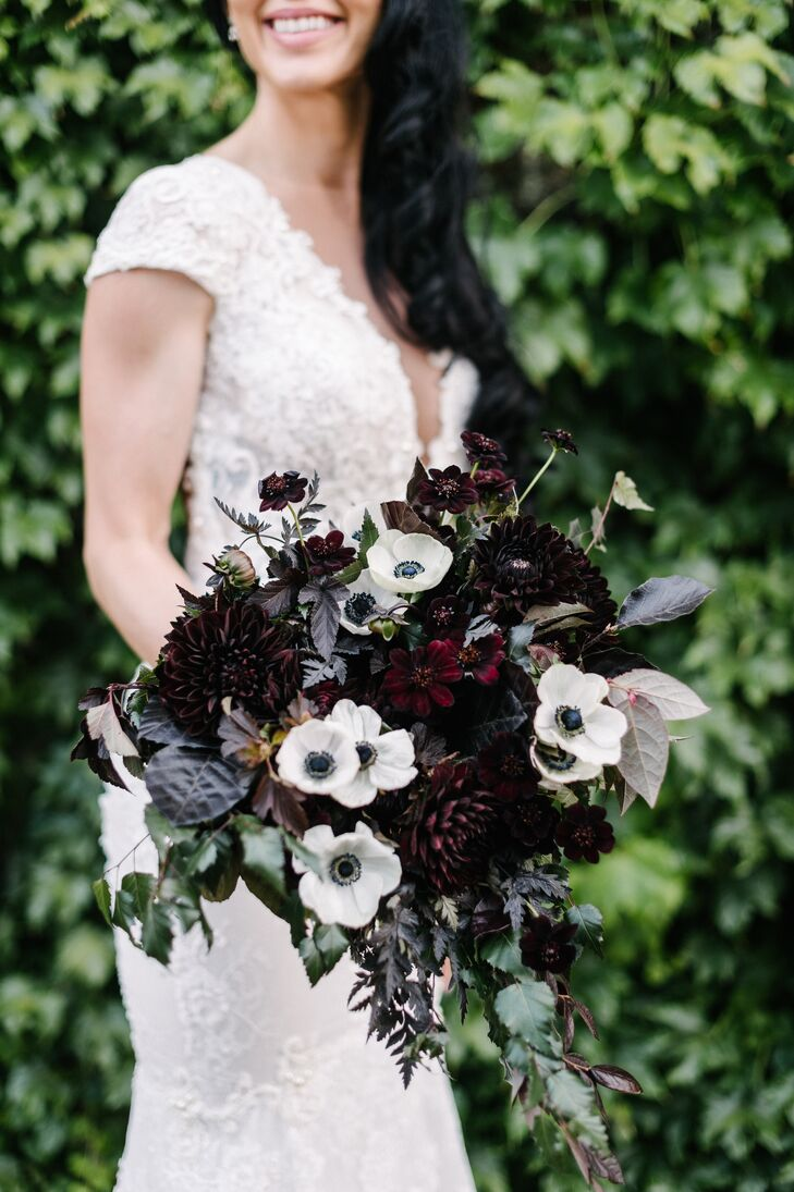 """My bouquet was the most amazing thing I have ever seen,"" Jeanne says of her moody, romantic arrangement. It was crafted with crimson ranunculus, dahlias and greenery."