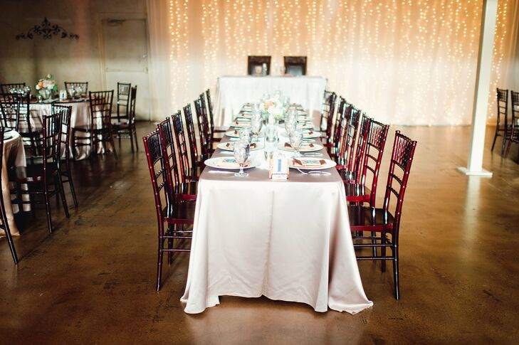 Long, banquet-style tables at the indoor reception were topped with crisp white tablecloths and cactus centerpieces.