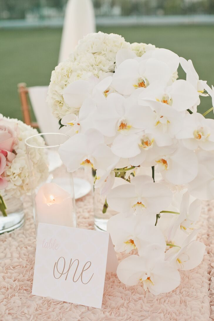 From the invitations to the menus and table numbers, each of the wedding's stationery elements featured the same quilted design, pale pink, ivory and gold color palette and playful script to create a cohesive feel throughout the event.