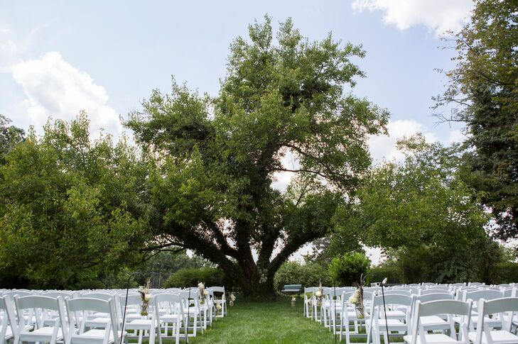 """Alison and Chris had their wedding ceremony at the Antrim 1844 Country House Hotel's secret garden where rose petals and shepherds' hooks lined the aisle. """"I joke because I said I always wanted a secret garden wedding and we got married under a tree that the Antrim calls the secret garden,"""" Alison says."""
