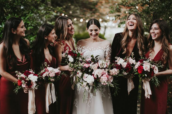 Bridesmaids with Burgundy Dresses and Romantic Bouquets with Pink Ribbon
