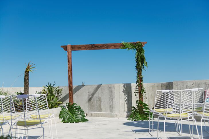 Diana and Stephan said their vows on the rooftop of the El Blok Hotel under a simple wood arbor decorated with a few green palm fronds.